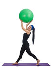 Young woman exercising with swiss ball Royalty Free Stock Photography