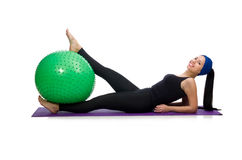 Young woman exercising with swiss ball Royalty Free Stock Images