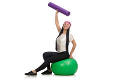 Young woman exercising with swiss ball Royalty Free Stock Photo