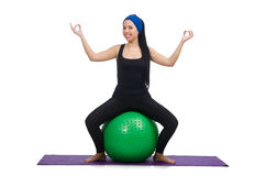 Young woman exercising with swiss ball Stock Image