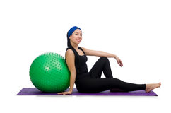 The young woman exercising with swiss ball Stock Images