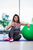 The young woman exercising with swiss ball in health concept Stock Photography