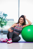 The young woman exercising with swiss ball in health concept Stock Image