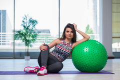 The young woman exercising with swiss ball in health concept Royalty Free Stock Photography