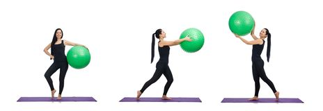 The young woman exercising with swiss ball royalty free stock image