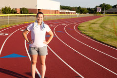 Young woman exercising on a track outdoors Royalty Free Stock Images