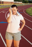 Young woman exercising on a track outdoors Royalty Free Stock Photos