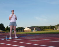 Young woman exercising on a track outdoors Stock Photography