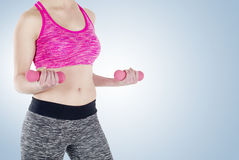 A young woman exercising Stock Images