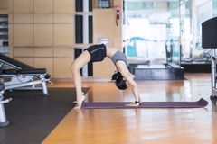 Young woman exercising yoga in backbend pose Royalty Free Stock Images