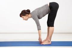 Young woman exercising yoga Stock Photography