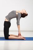 Young woman exercising yoga Royalty Free Stock Images