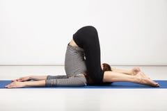 Young woman exercising yoga Stock Image
