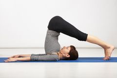 Young woman exercising yoga Royalty Free Stock Photography