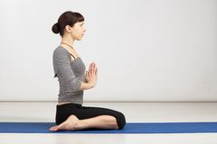 Young woman exercising yoga Royalty Free Stock Photo