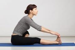 Young woman exercising yoga Stock Photo