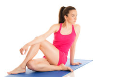 Young woman is exercising yoga Stock Image