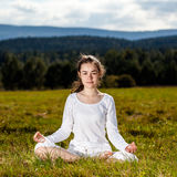Young woman exercising yoga outdoor Royalty Free Stock Photography