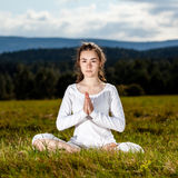 Young woman exercising yoga outdoor Stock Photos