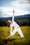 Young woman exercising yoga outdoor Stock Photography