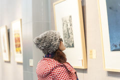 Girl in exhibition Stock Photo