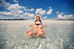 Young woman on exotic beach vacation Royalty Free Stock Photography