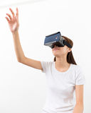 Young woman experience though the visual reality device Stock Photos