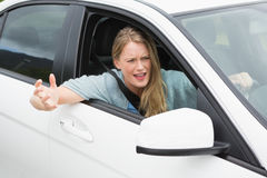 Young woman experiencing road rage Royalty Free Stock Photos