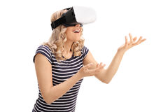 Young woman experiencing virtual reality. And gesturing with hands  on white background Royalty Free Stock Image