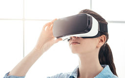Young woman experiencing virtual reality Stock Photo