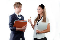 Young woman explaining something to young man Royalty Free Stock Photos