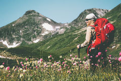 Young Woman explorer hiking at mountains. Travel Lifestyle wanderlust concept summer vacations outdoor with backpack Royalty Free Stock Images