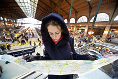 Young woman explores map of Paris Stock Photo