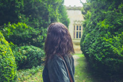 Young woman exploring formal garden Royalty Free Stock Photography