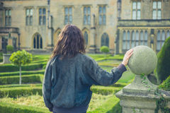 Young woman exploring formal garden Royalty Free Stock Image