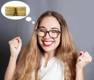 Young woman is expressing the desire to have money. A young woman is expressing the desire to have money Stock Photos