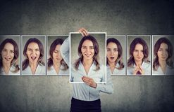 Young woman expressing different emotions. Young beautiful masked business woman expressing different emotions and feelings royalty free stock photography