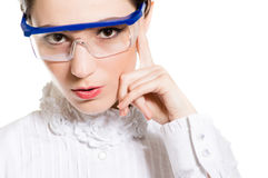 Young woman in eye shields looking thoughtful and puzzled. Closeup on young woman in eye shields looking thoughtful and puzzled isolated over white background Royalty Free Stock Image