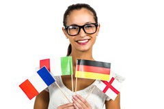 Young woman with eyeglasses holding flags Stock Images