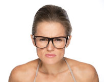 Young woman in eyeglasses looking attentively in camera Stock Photo