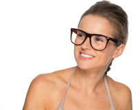 Young woman in eyeglasses looking on copy space Stock Images