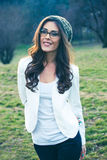 Young woman with eyeglasses outdoor portrait. Smiling young woman with eyeglasses outdoor portrait winter day Stock Images
