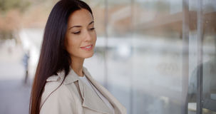 Young woman eyeing an item for sale Royalty Free Stock Photography
