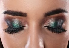 Young woman with eyelash extensions. And beautiful makeup, closeup view stock photography