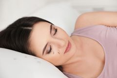 Young woman with eyelash loss problem sleeping royalty free stock photography