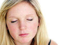 Young woman with eyes closed. Young blonde woman with eyes closed on white background Stock Images