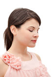 Young woman with eyes closed. Close up portrait of a beautiful young woman facing away from the camera, wearing a pink dress, and eyes closed, isolated on white stock photos