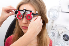 Young woman during eyes examination Stock Photo