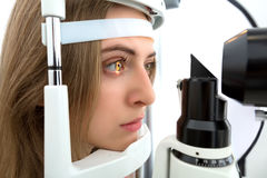 Young woman during eyes examination. With phoropter at optometric clinic Stock Images
