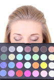 Young woman with eyeshadow palette Royalty Free Stock Photography